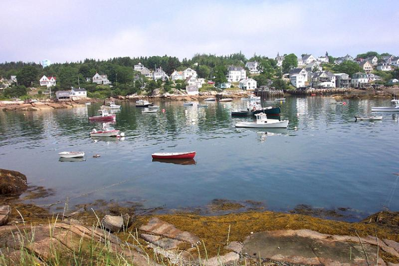 Stongington Maine harbor with fishing vessells and row boats.