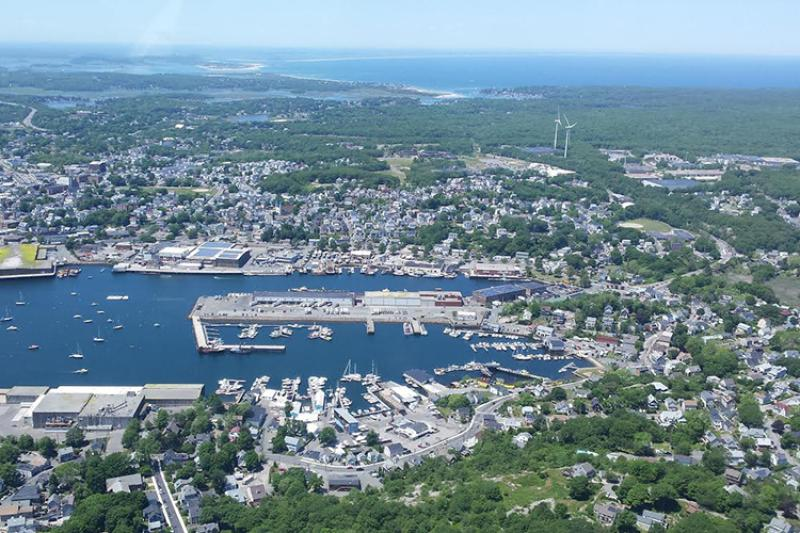 Gloucester, Massachusetts as seen from the air. Harbor is center wind turbines to the right.
