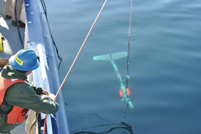 Crew member lowering a towbody.