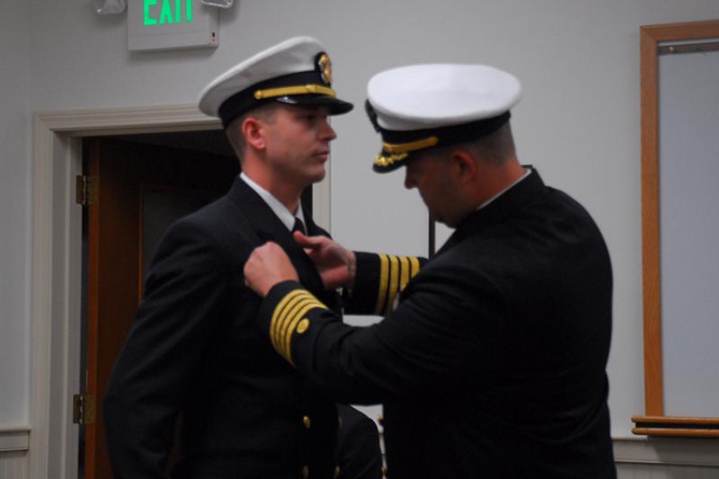 Ben VanDine being pinned during transfer ceremony.