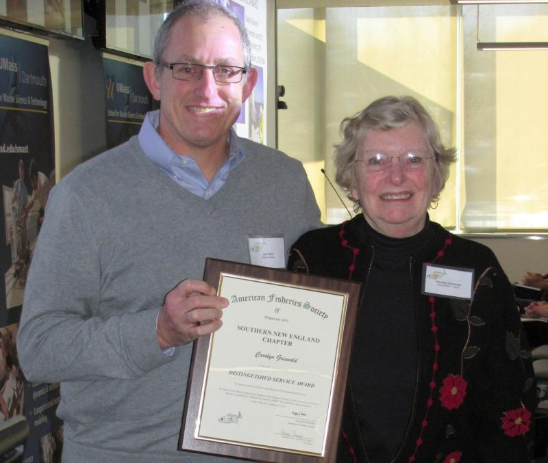 Award given to Carolyn Griswold by Jon Hare