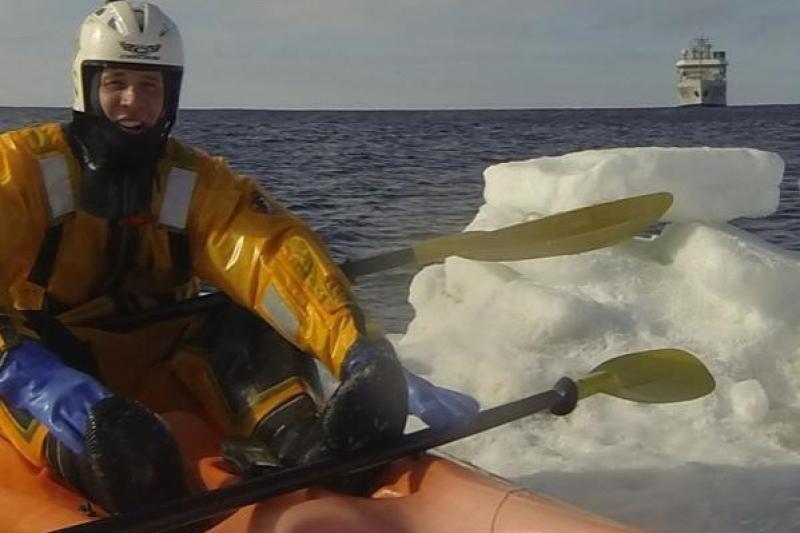 Benjamin VanDine kayaking in icy waters.