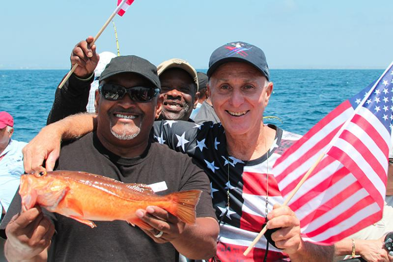 larry brown celebrates a successful catch with veterans aboard the Betty O.jpg