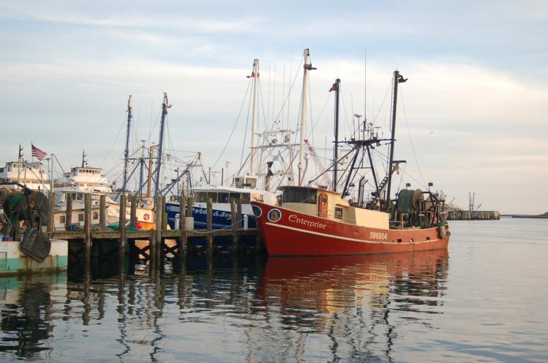 Point Judith dock with various fishing vessels.