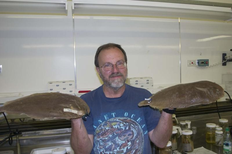 Tom Munroe with Peltorhamphus novaezeelandiae Photo Credit C. Struthers.jpg