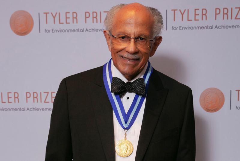 Warren Washington wearing the Tyler Prize ribbon.